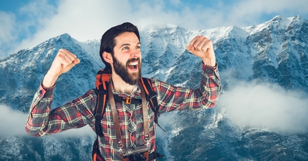 Digital composite of Happy rambler in front of snow-covered mountains background