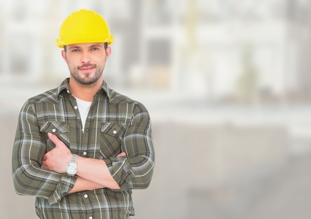 Digital composite of Construction Worker in front of construction site Stock Photo