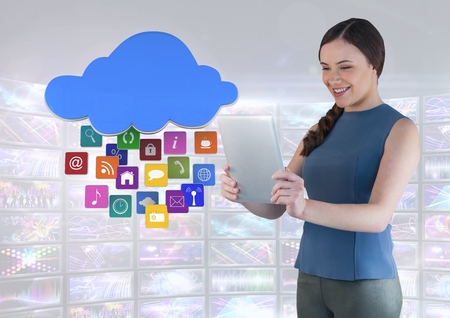 Digital composite of Businesswoman holding tablet with apps