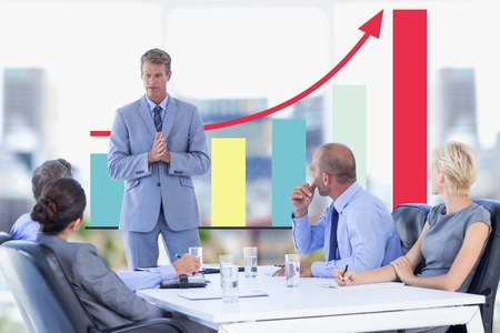 Digital composite of Business meeting in front of digital screen with graphics Stock Photo