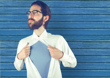 Digital composite of hipster opening the t-shirt with blue wood background