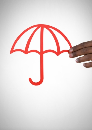 Digital composite of Cut out of umbrella in hand Stock Photo