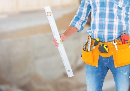Digital composite of Carpenter with spirit level on building site Stock Photo