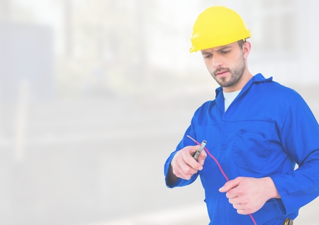 Digital composite of Electrician with wires cables on building site