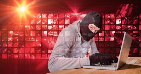 sleeveless hoodie: Digital composite of Housebreaker typing on laptop in front of red digital screen