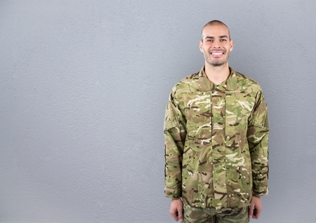 Digital composite of happy soldier. concrete wall Stock Photo