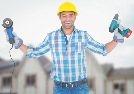 Digital composite of Construction Worker with drill in front of construction site Stock Photo