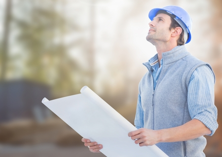 unloading: Digital composite of Architect with blueprints on building site Stock Photo