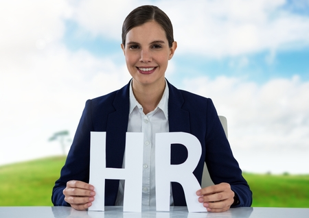 Digital composite of Cut out HR letters with landscape Stock Photo