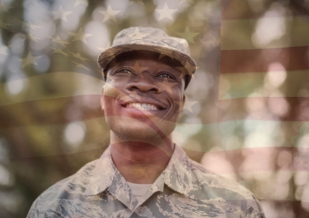 militant: Digital composite of happy soldier smiling overlap with usa flag
