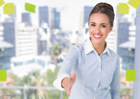 post it: Digital composite of happy business young woman giving hand to handshake in front of the window of the offie