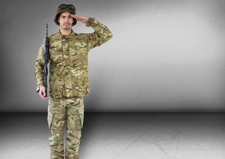 militant: Digital composite of soldier saluting and with weapon. Concrete room