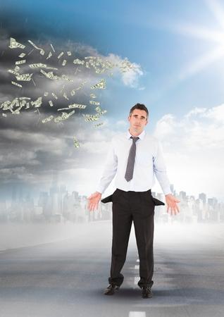 Digital composite of Poor businessman in front of his flying money