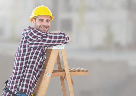 Digital composite of Construction Worker on ladder in front of construction site
