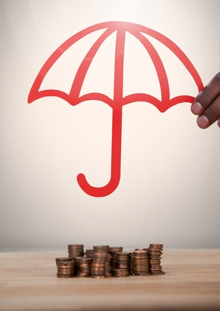 Digital composite of Cut out of umbrella protecting money coins