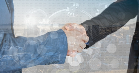 reach out: Digital composite of business hand shake overlap with city, graphs and numbers Stock Photo