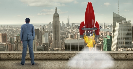 Digital composite of Digital composite image of businessman while launching rocket against cityscape