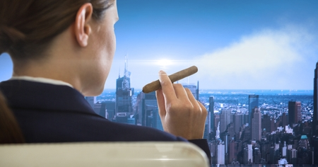 cigar smoking woman: Digital composite of Rear view of businesswoman sitting in chair smoking looking at cityscape