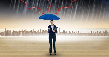 scarf beach: Digital composite of Digital composite image of lightening arrows on blue umbrella held by businesswoman standing in rain