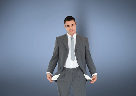 man holding transparent: Digital composite of Portrait of businessman with empty pockets standing against gray background representing no money