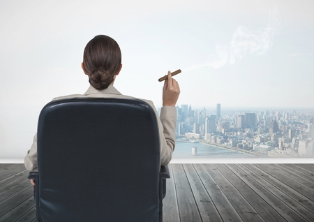 cigar smoking woman: Digital composite of Rear view of businesswoman sitting on chair and smoking cigar while looking at city