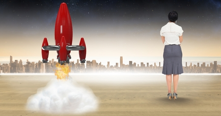 Digital composite of Digital composite image of businesswoman looking at rocket launch against city