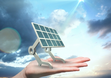 Digital composite of Digital image of solar panel on hand against sky
