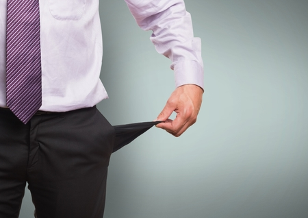 Digital composite of Midsection of businessman showing empty pocket standing against green background