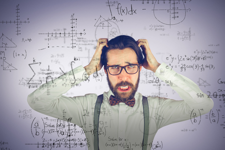 Frustrated man scratching head against grey vignette