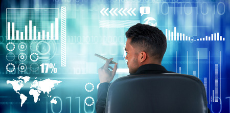 round chairs: Rear view of male executive holding cigar against blue technology design with binary code Stock Photo
