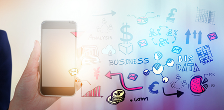 Mid section of businesswoman holding mobile phone against glowing background
