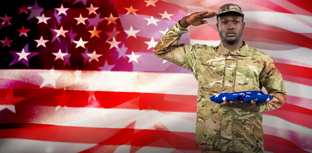 Portrait of soldier holding an american flag while  against close-up of american flag