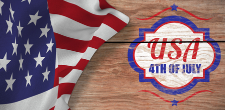 Digitally generated image of 4th of july text  against brown wood panelling Stock Photo