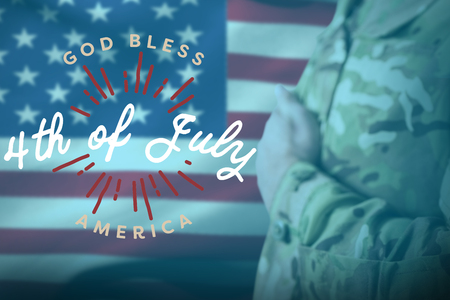 militant: Mid section of military soldier taking oath against digitally generated image of happy 4th of july message Stock Photo