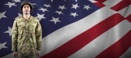 militant: Portrait of confident soldier standing against close up of the us flag