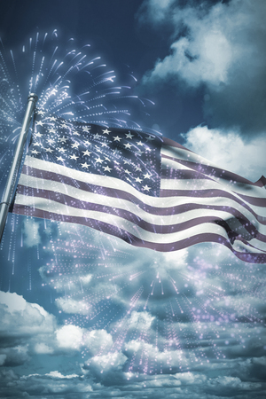 View of beautiful sky and clouds against digitally generated american national flag