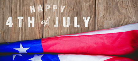 panelling: Digitally generated image of happy 4th of july text against close-up of wooden texture