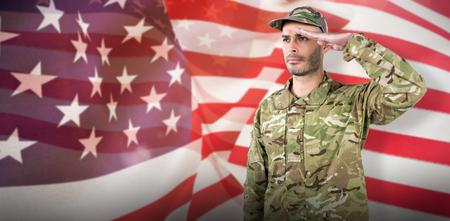 militant: Confident soldier saluting against focus on usa flag