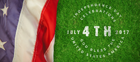 Multi colored happy 4th of july text against white background against closed up view of grass