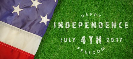 Computer graphic image of happy 4th of july text against closed up view of grass Stock Photo