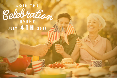 Computer graphic image of independence day message against happy family having a picnic Stock Photo
