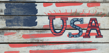 digitally generated image: Digitally generated image of USA text against wood background