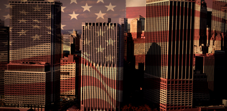 Digitally generated united states national flag against high angle view of modern buildings