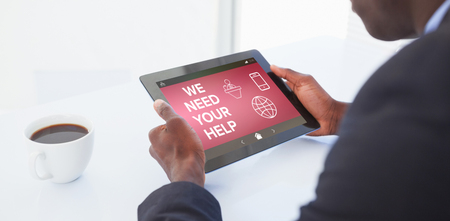 using tablet: We Need your Help text with various icons on screen against businessman using digital tablet