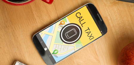 using smart phone: Digitally generated image of mobile phone with text and map against smartphone on desk Stock Photo