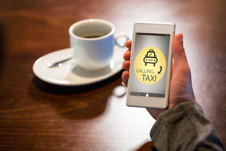 Vector image of Taxi calling text with icon  against hand holding mobile phone