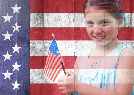 spangled: Digital composite of Little girl holding american flag against american flag Stock Photo