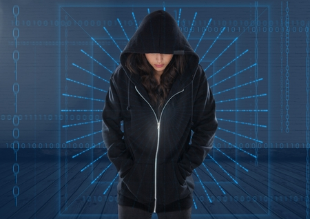 Digital composite of Woman hacker with hands in pocket in front of digital blue background Stock Photo