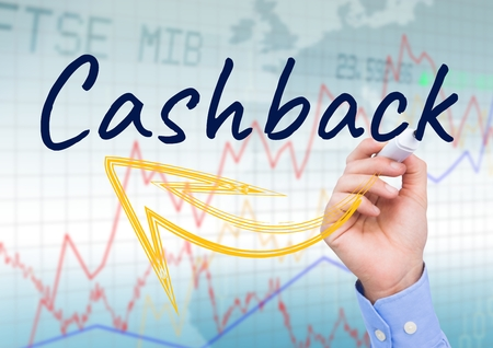 cross legged: Digital composite of CASHBACK with yellow arrow write on the screen. Stock market background