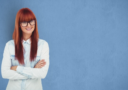 Digital composite of Happy female hipster with redhead over blue background